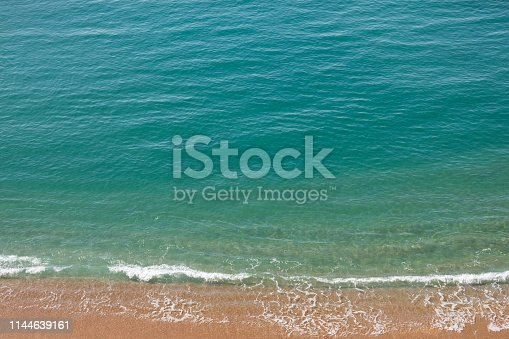 999001484 istock photo Paradise beach and waves 1144639161