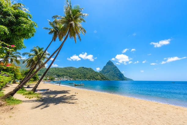 paradise beach at soufriere bay with view to piton at small town soufriere in saint lucia, tropical caribbean island. - caribbean stock pictures, royalty-free photos & images