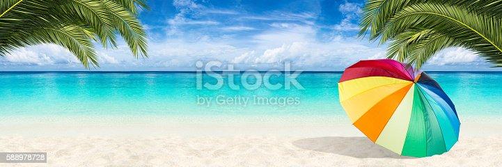 istock paradise beach parasol background 588978728