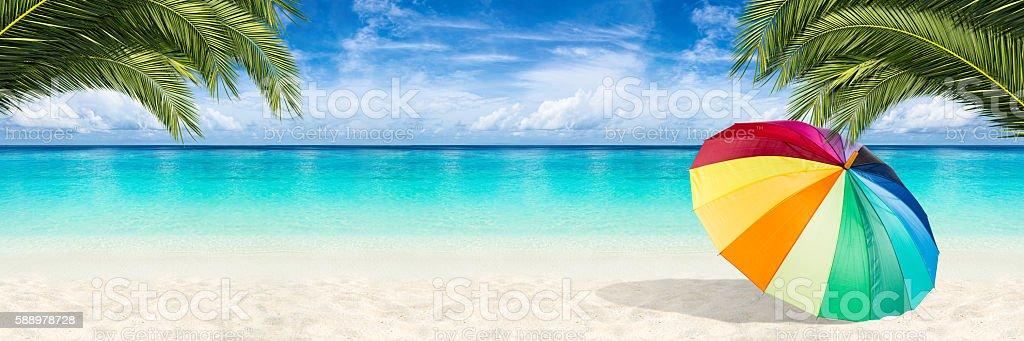 paradise beach parasol background stock photo