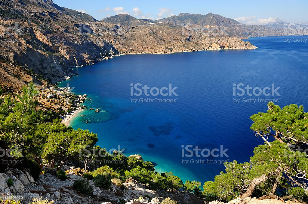 Paradise beach surrounded by mountains royalty-free stock photo