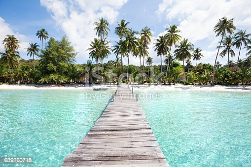 paradise beach with turquoise water, wooden pier and tropical palm trees, summer holidays in Thailand, Koh Kood