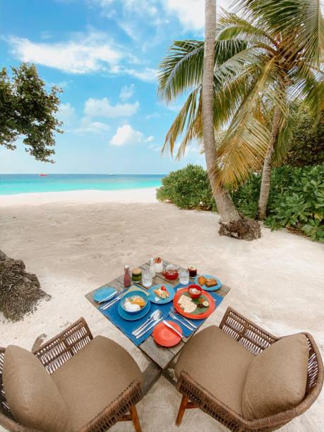 Paradise breakfast by the beach stock photo