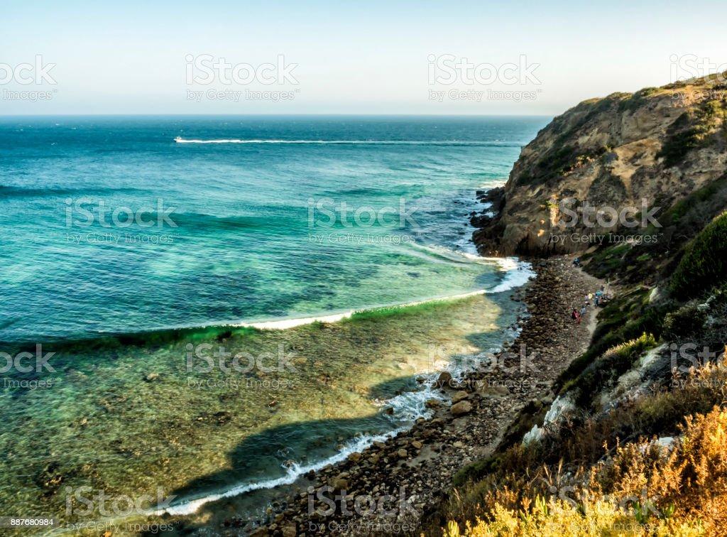 Paradise Cove Malibu, Zuma Beach, emerald and blue water in a quite paradise beach surrounded by cliffs. Malibu, Los Angeles, LA, California, CA, USA stock photo
