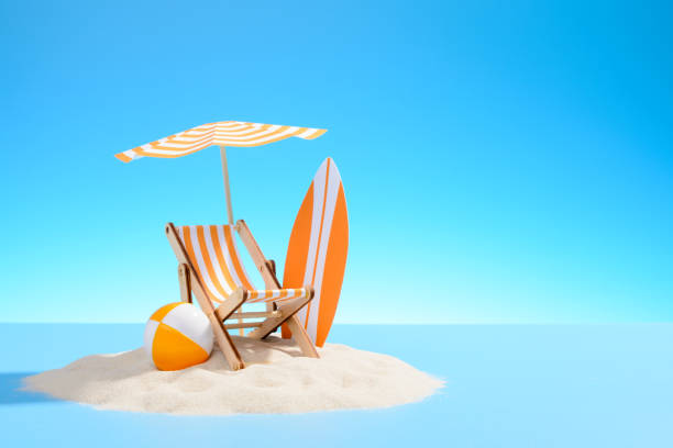 Paradise island in the ocean. Paradise island in the ocean. Miniature beach accessories for outdoor activities. Blue background with copy space chaise longue stock pictures, royalty-free photos & images