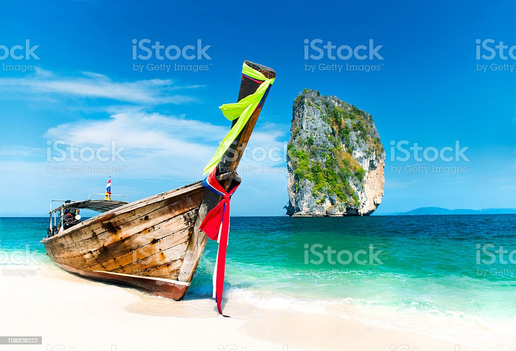 Paradise Island with a Longtail boat stock photo