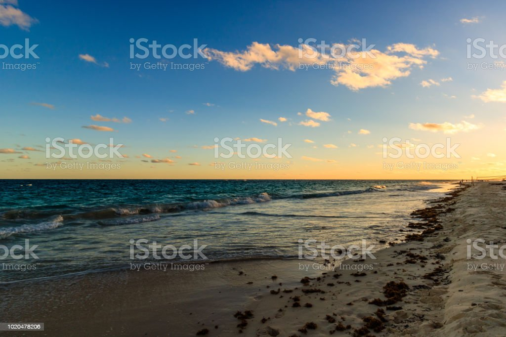 Paradise travel destination beach in Hamilton, Bermuda. Elbow Beach with golden sand and a beautiful sunset. stock photo