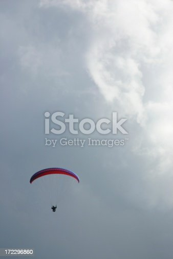 A paraglider rides the wind looking for thermal air currents