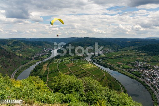 Paraglider above the Mosel loop in Bremm, Germany
