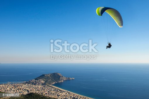 Paraglider airborne with a nice aerial view