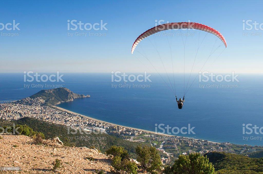 Paraglider airborne stock photo