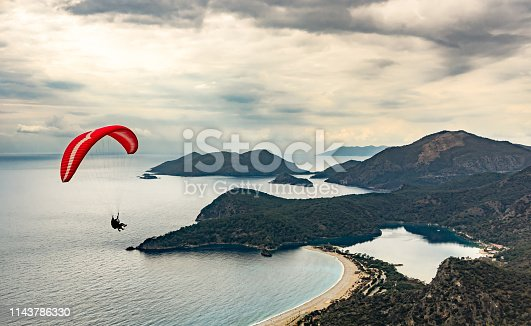 istock Paraglider flying on Oludeniz beach in Fethiye, Mugla, Travel destination 1143786330