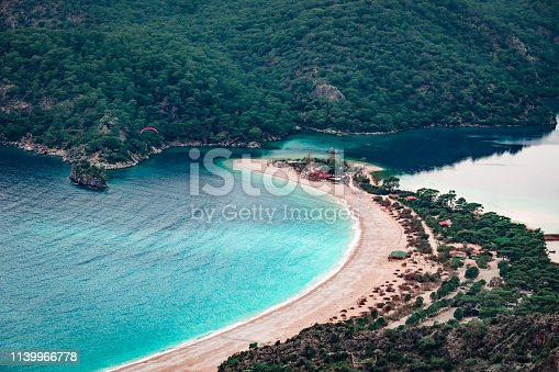 istock Paraglider flying on Oludeniz beach in Fethiye, Mugla, Travel destination. Summer and holiday concept. Lycian way. Panoramic view. 1139966778