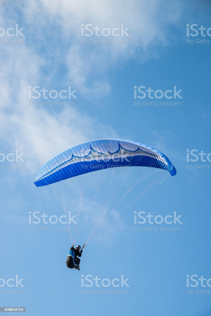 Paraglider in action stock photo