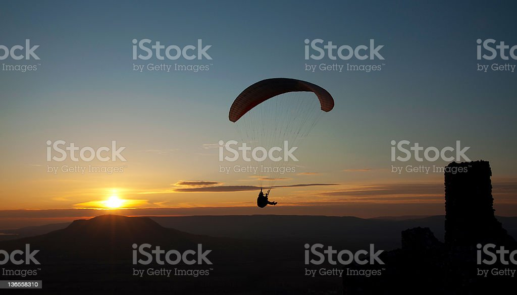 Paraglider in sunset royalty-free stock photo