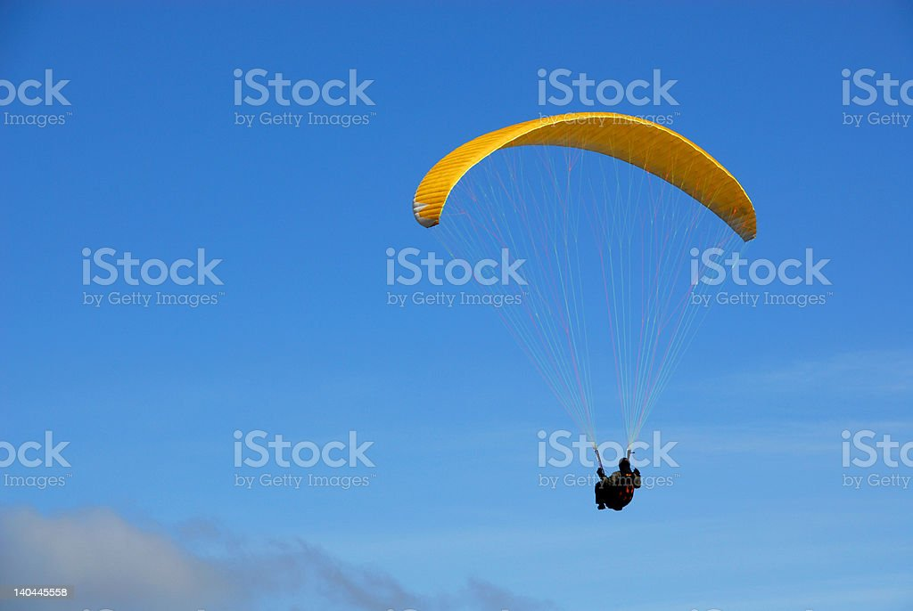 Paraglider in the blue stock photo