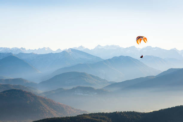 paraglider in the mountains Mountain Scenery in Germany parachuting stock pictures, royalty-free photos & images