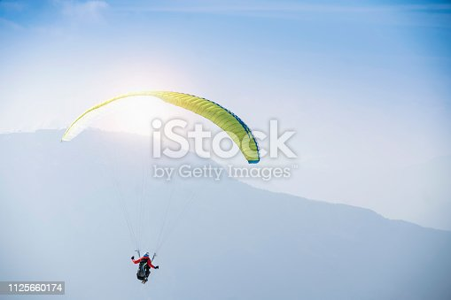 Paraglider over mountains