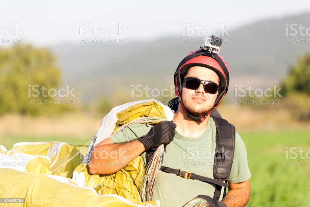 Paraglider Pilot Walking When After Landing stock photo