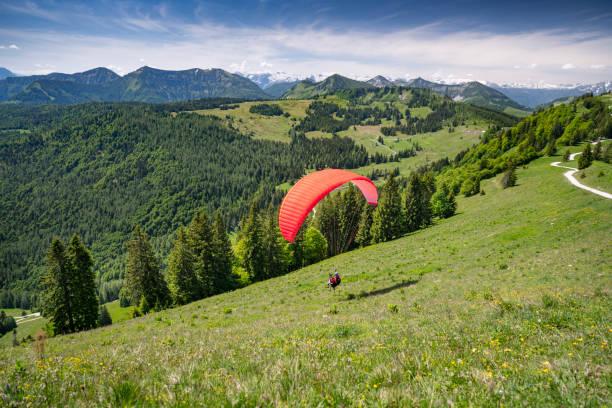Paraglider starting, Zwölferhorn, Salzkammergut, Austria Paraglider starting, Zwölferhorn, Salzkammergut, Austria. Nikon D850. Converted from RAW. paragliding stock pictures, royalty-free photos & images