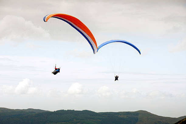 Paragliders flying over Jenkin Fell stock photo