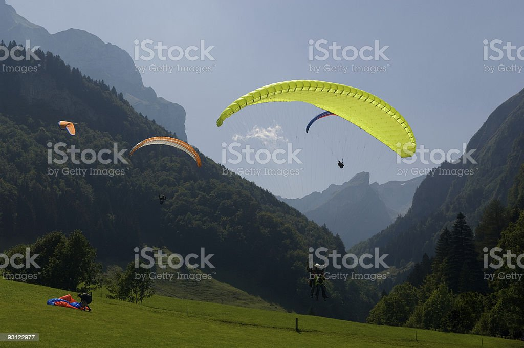 Paragliders in the Swiss Alps stock photo