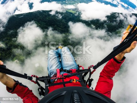 Flying over the clouds with a paraglider