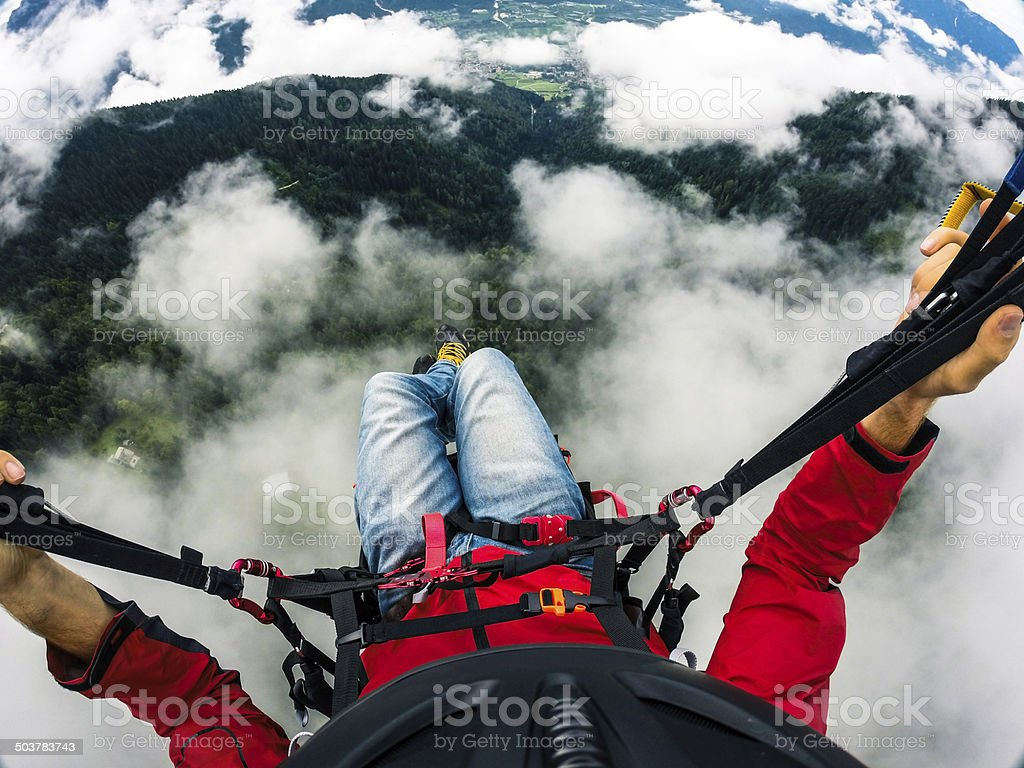 Paraglider's point of View, Flying over the Clouds stock photo