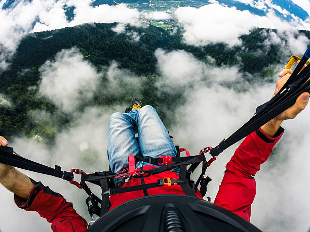 Paraglider's point of View, Flying over the Clouds Flying over the clouds with a paraglider paragliding stock pictures, royalty-free photos & images