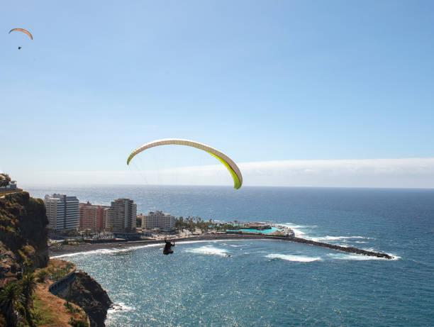 Paragliding above cliffs of  Puerto de la Cruz stock photo