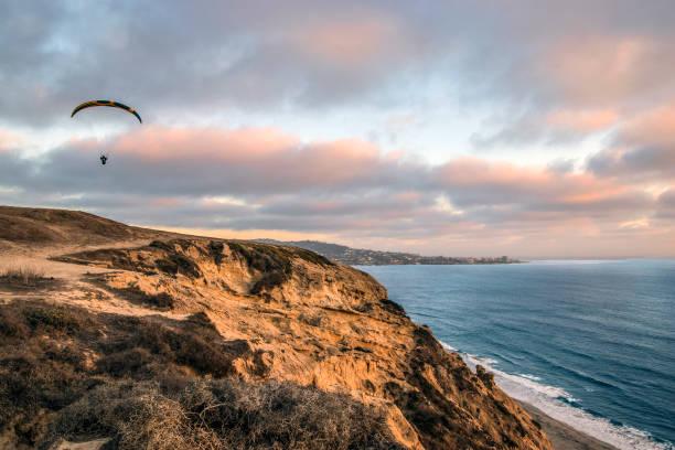 Paragliding above the La Jolla cliffs stock photo