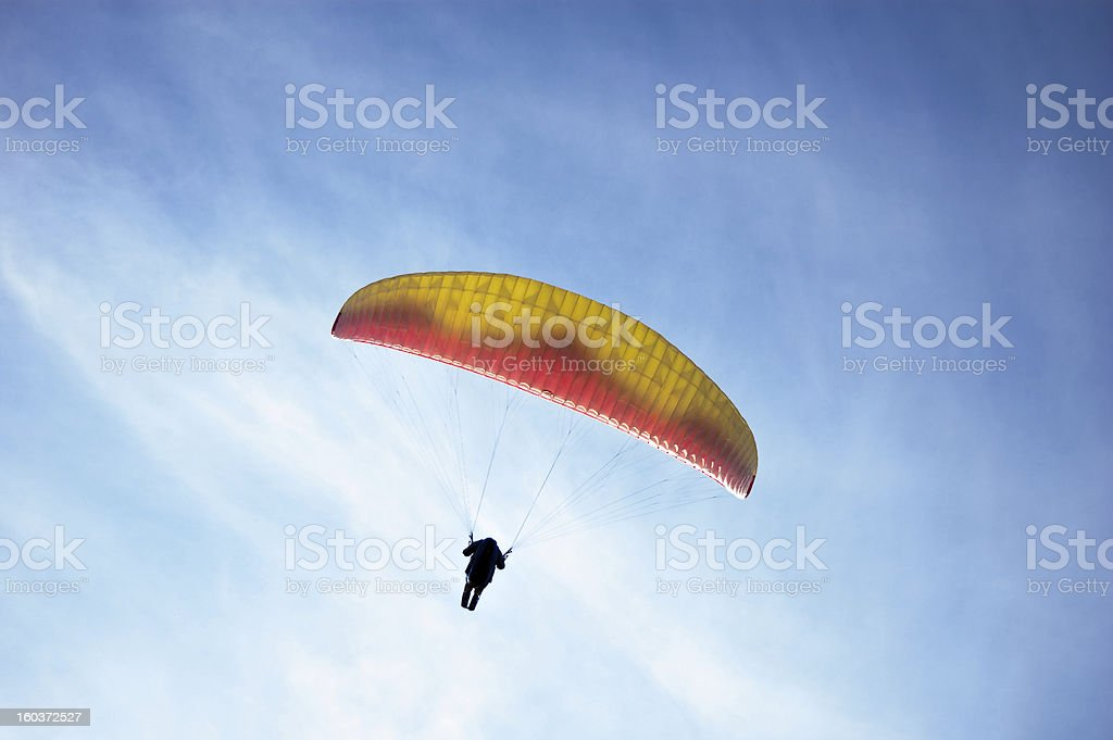 Paragliding against a rich blue sky royalty-free stock photo