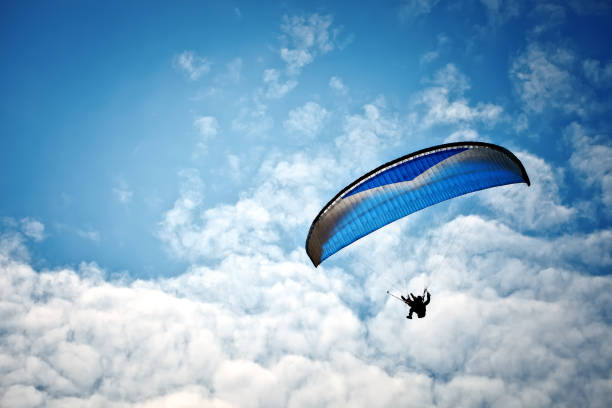 Paragliding along beautiful coastline Paragliding along the beautiful coastline. Beautiful summer background. Sport. paragliding stock pictures, royalty-free photos & images