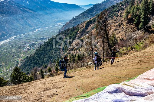 Paragliding in snow cap mountains of Himalayas image is taken at manali india on Mar 23 2019 showing its amazing natural view.