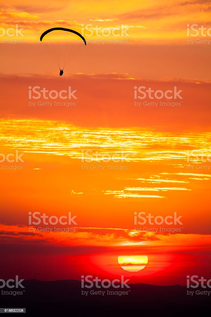 Paragliding in sunset stock photo