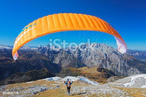 istock Paragliding in the Alps, paraglider starting a flight at Watzmann - Nationalpark Berchtesgaden 904805776