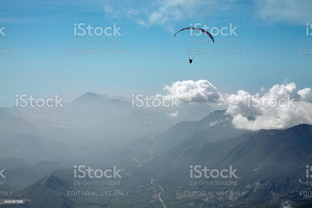 Paragliding in the mountains stock photo