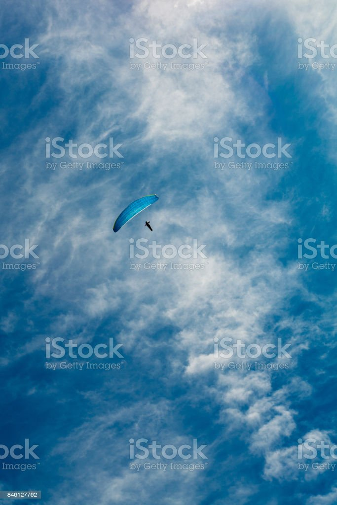 Paragliding in the sky over the dolomites stock photo