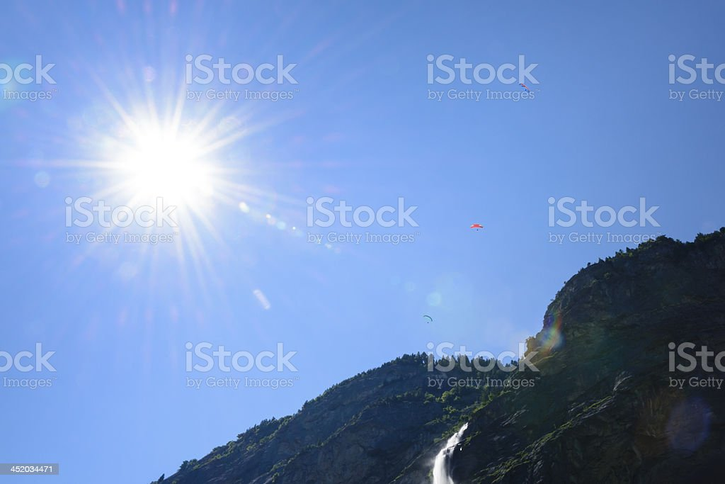 Paragliding over a cliff and waterfall royalty-free stock photo
