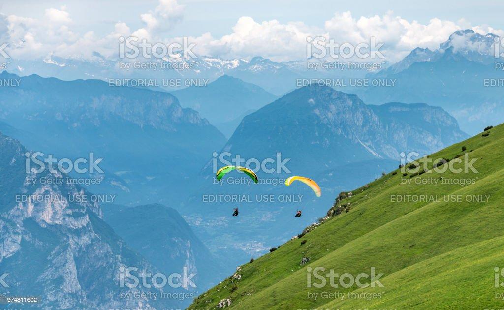 Paragliding over Monte Baldo and Lake Garda in Italy stock photo
