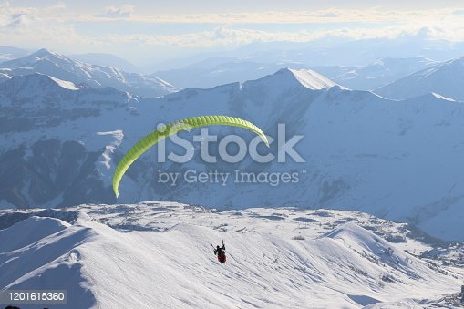 Beautiful view of snow mountains and paragliding