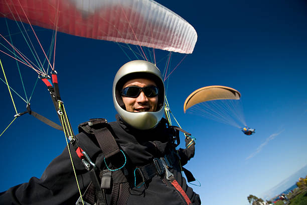 Paragliding Pilot  paragliding stock pictures, royalty-free photos & images