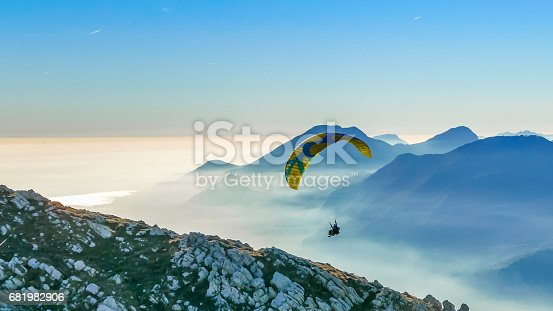 istock Paragliding tandem landing on the mountain slope 681982906