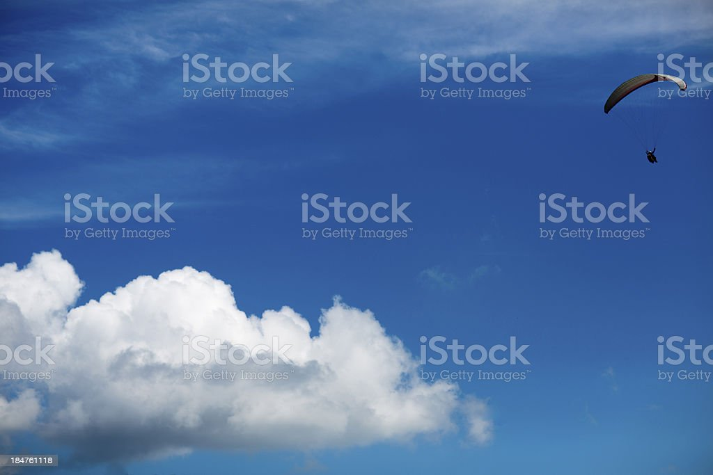 Paragliding white clouds in the blue sky background royalty-free stock photo