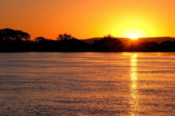 Paraguay River at sunset between Corumba and Porto Jofre, Pantanal, Mato Grosso do Sul, Brazil stock photo