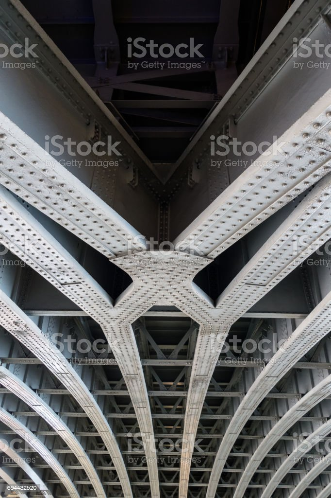 Parallel joined steel beams supporting bridge span stock photo