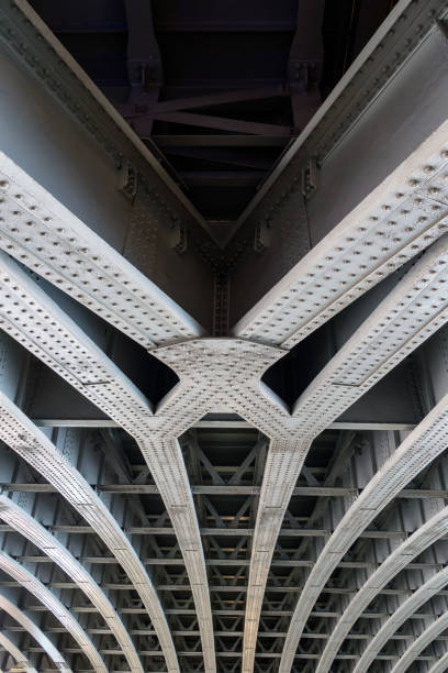 parallel joined steel beams supporting bridge span - physical structure stock photos and pictures