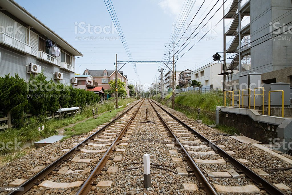 Parallel tracks Parallel railway tracks leading off into the distance. This was taken in a suburb near Tokyo, Japan (unsharpened). Asia Stock Photo