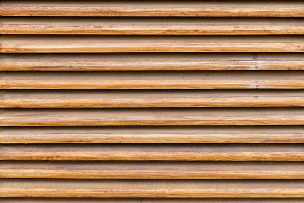 Textura de listones de madera paralelas. Persianas de madera, como elemento de decoración. - foto de stock
