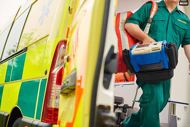 paramedic and ambulance stock photo